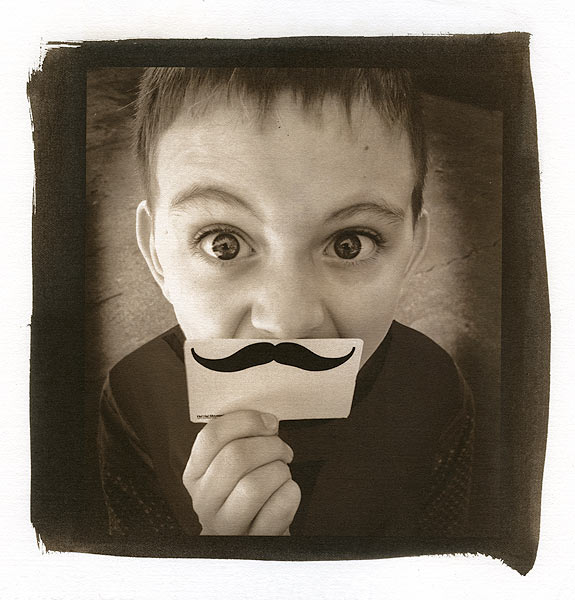 A boy with a funny moustache